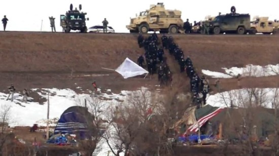 U.S. National Guard and police sweep the Dakota Access pipeline protest camp on Feb. 23, 2017. (source: livestream.com / Unicorn Riot)
